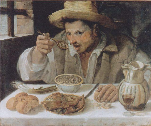 アンニーバレ・カッラッチ 《The Beaneater》、1584~1585、キャンバスに油彩、57×68cm 、イタリア、コロンナ美術館